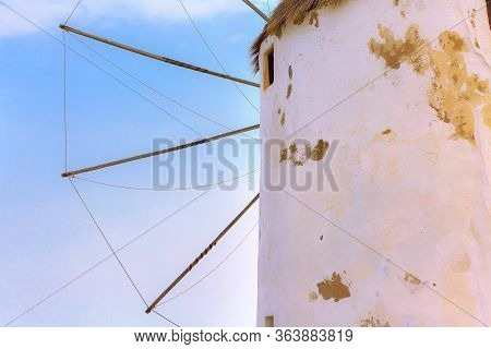 Greek Iconic Windmill Close-up Background In Mykonos, Greece, Famous Island In Cyclades