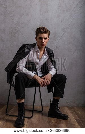 Young Fashionable Hipster Man In A Stylish Black Leather Jacket In A White Classic Shirt In Jeans In