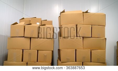 Large Cardboard Boxes In Stock Before Shipping. A Set Of Cardboard Boxes In An Industrial Refrigerat