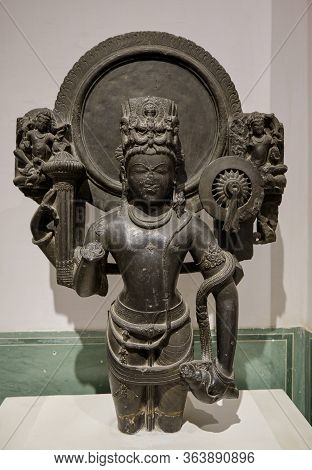Black Stone Sculpture Of Vishnu With A Halo In Albert Hall Museum In Jaipur, India