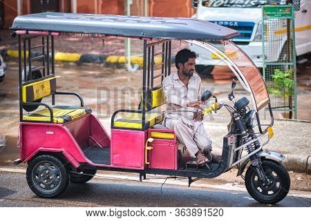 Jaipur, Rajasthan / India - September 29, 2019: Driver Sitting In His Tuk Tuk, Waiting For Customers