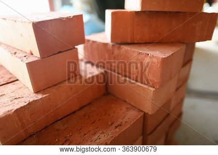 Building Materials Are On Floor, Stack Red Bricks. Production High-quality Ceramic Brick Matte, Redd