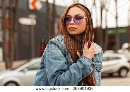 Portrait Sexy Modern Young Woman Hipster In Fashionable Purple Glasses In A Stylish Oversized Denim