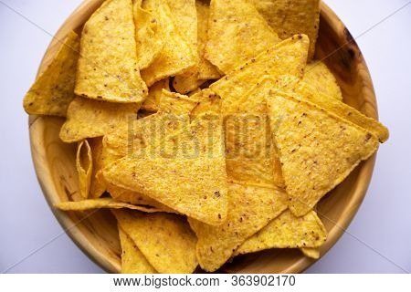 Bowl Of Tortilla Chips On White Surface, Top View. Mexican Food.