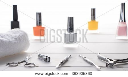 Manicure Or Pedicure Set Tools Are Placed On A Table With A White Towel In The Beauty Salon. Equipme