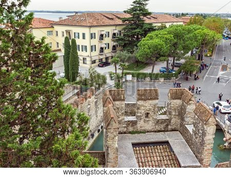 Sirmione, Italy - October 01, 2015 : View Of The City Located Behind The Walls Of The Castello Scali