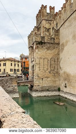 Sirmione, Italy - October 01, 2015 : The Water Moat Filled With Water In Front Of The Walls Of The C