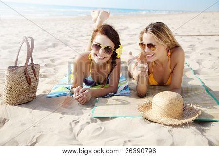 two female friends having fun on the beach