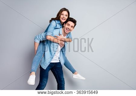 Portrait Of Cheerful Romantic Student Couple Man Woman Hug Embrace Piggyback Enjoy Weekend Rest Rela