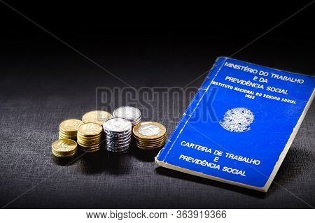 Old Brazilian Work Card, With Coins And Real Notes. Text Written In Portuguese: Ministry Of Labor, W