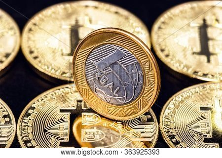 One Real Coin, Money From Brazil, Over Several Bitcoin Currencies. Digital Currency Mining Concept.