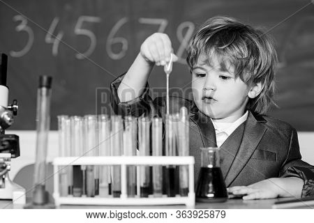 Education Concept. Experimenting With Chemistry. Talented Scientist. Boy Test Tubes Liquids Chemistr