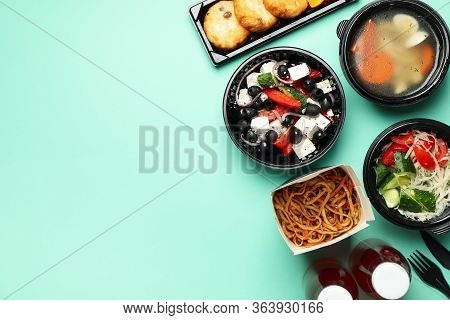 Food Delivery. Food In Takeaway Boxes On Mint Background