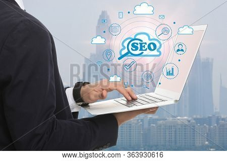Seo Directions With Icons Of Keyword Research, Customization And Others. Man Using Laptop
