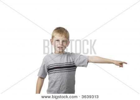 A Young Boy Points His Finger