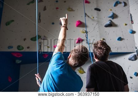 People climbing in indoor climbing gym