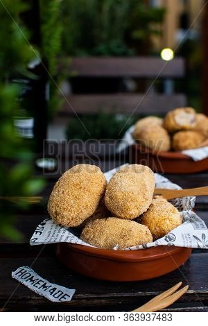 Traditional Spanish Tapas, Croquettes, Croquetas With Cod Fish On Rustic Wooden Background