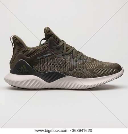 Vienna, Austria - February 19, 2018: Adidas Alpha Bounce Beyond Olive Green Sneaker On White Backgro