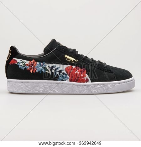 Vienna, Austria - February 19, 2018: Puma Suede Hyper Embellished Black And White Sneaker On White B