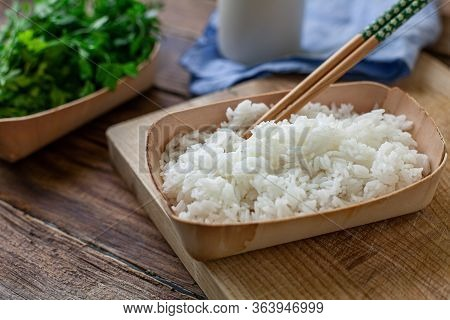 Boiled Rice On A Bambu Bowl With Parsley