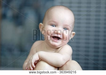 Portrait Of Little Cheerful Baby With Short Hair Without Shirt. Happy Small Smiling Child Leaning On