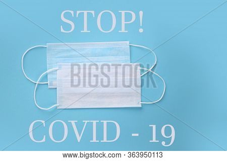 Disposable Blue Face Masks To Stop Covid -19 On A Blue Background