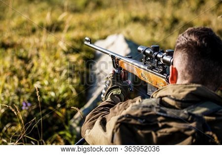 Hunting Period. Male With A Gun. Close Up. Hunter With Hunting Gun And Hunting Form To Hunt. Hunter