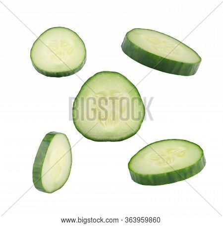 Falling Cucumber Slice Isolated On White Background, Close Up Vegetable In Air. Green Fresh Cucumber