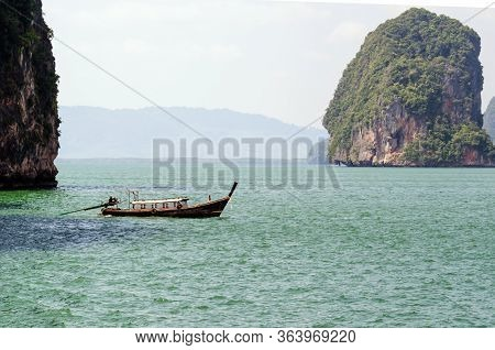 Traditional Thai Longtail Boats In The Andaman Sea.