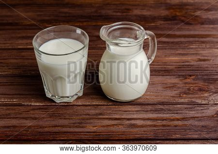 Homemade Fermented Beverage In A Glass Of Kefir On A Wooden Background. Sour Milk Drink, Sourdough F