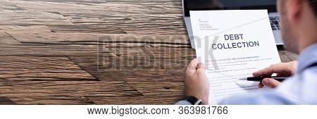 Man Reading Unpaid Debt Collection Bill Letter
