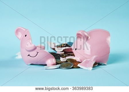 Broken Piggy Bank With Coins Money On Blue Background With Copy Space
