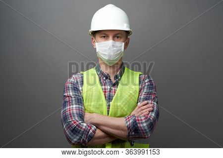 Worker Man Wearing Hygienic Mask And Protective Hard Hat.