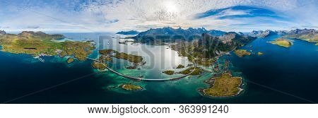 Fredvang Bridges Panorama. Lofoten islands is an archipelago in the county of Nordland, Norway. Is known for a distinctive scenery with dramatic mountains and peaks, open sea and sheltered bays.