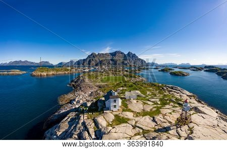 Henningsvaer Lofoten is an archipelago in the county of Nordland, Norway. Is known for a distinctive scenery with dramatic mountains and peaks, open sea and sheltered bays, beaches and untouched lands