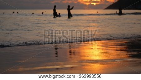 Sunset on sand beach in golden color