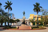 Matanzas Cuba - main square. Palm trees and statue depicting Jose Marti and Liberty. poster