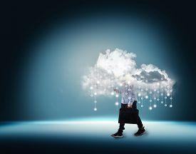 Businessman With Cloud Inside A Cloud On Blue Futuristic Background . Big Data Transfer And Artifici