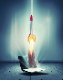 Startup Concept With Rocket Flying Out Of Laptop. Start Online Business . This Is A 3d Render Illust