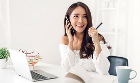 Portrait Of Smiling Happy Beautiful Asian Woman Relaxing Using Technology Of Laptop Computer While S