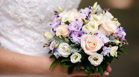 Wedding Bouquet Of Flowers In Bride Hands.