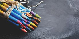 Colorful Pastel Crayons On Blackboard Background With Copy Space. Art, Drawing Concept.