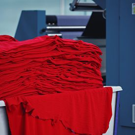 Material On The Textile Factory. Red Clothing Texture Material Textile Background.