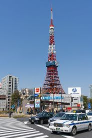 Tokyo, Japan - Mar 15, 2019: View Of Tokyo Tower And Taxis In Japan. The Tower Is A Prominent Landma