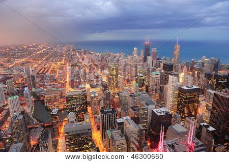 Chicago downtown aerial view at dusk with skyscrapers and city skyline at Michigan lakefront. poster