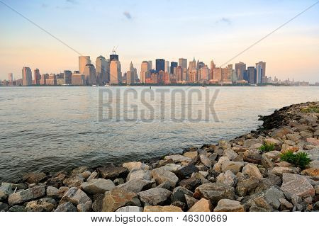New York City Manhattan downtown skyline at sunset over Hudson River panorama viewed from New Jersey shore
