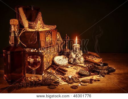 Closeup on treasure still life, luxury vintage accessories, pirates booty, bottle with rum, fish skeleton, cigars and golden coins, dangerous adventure concept poster