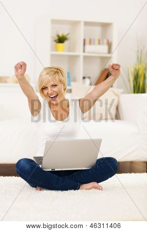 Happy young woman with hands raised