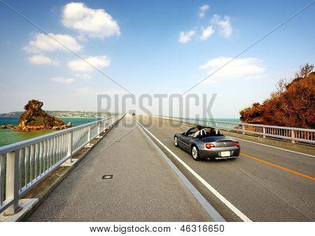 OKINAWA JAPAN - NOVEMBER 14: Vehicular traffic passes over Kurima Bridge November 14, 2012 in Okinawa, JP. It is Considered the longest farm road bridge in Japan at a lenght of 1,690 meters.