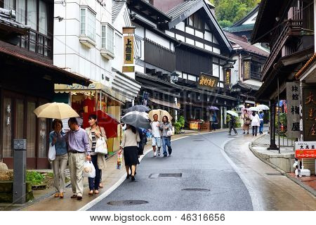 NARITA, JAPAN - OCTOBER 6: Shoppers pass through Sando traditional street October 6, 2012 in Narita, JP. The historic town is a popular destination located near Narita International Airport.